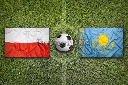 poland vs kazakhstan flags on soccer