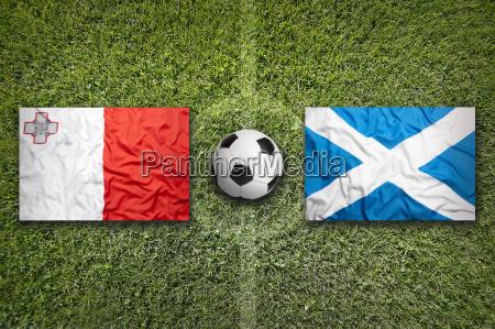 malta vs scotland flags on soccer