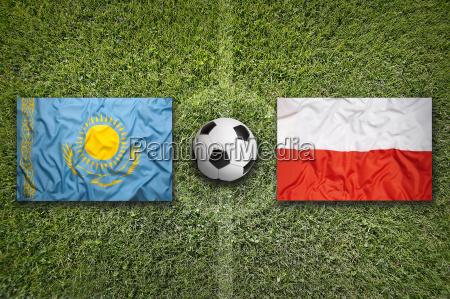 kazakhstan vs poland flags on soccer