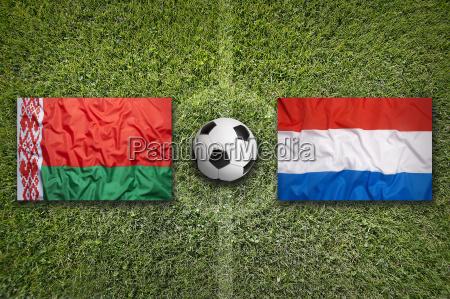 belarus vs netherlands flags on soccer