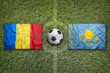romania vs kazakhstan flags on soccer