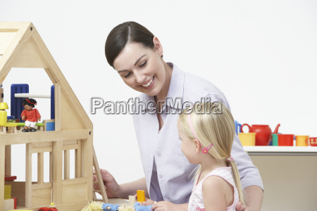 pre-school, teacher, and, pupil, playing, with - 19409110