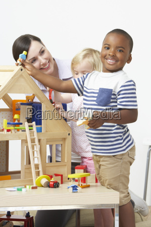 pre-school, teacher, and, pupils, playing, with - 19409104