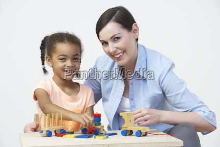 teacher, and, pre-school, pupil, playing, with - 19409234