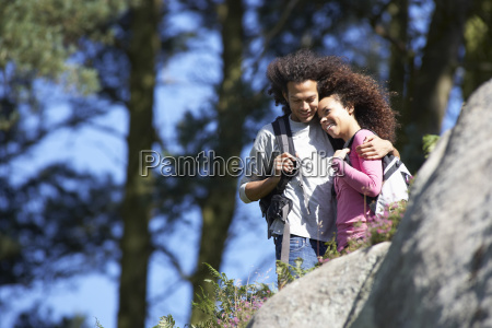 young, couple, on, hike, in, countryside - 19409026