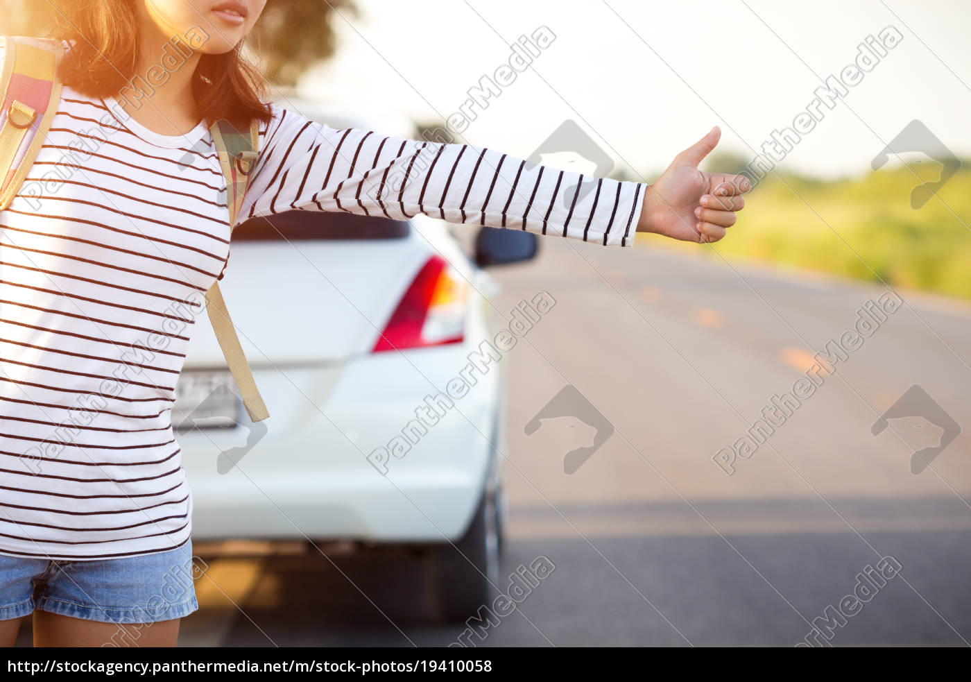 woman, hitchhiking, looking, for, help, with - 19410058