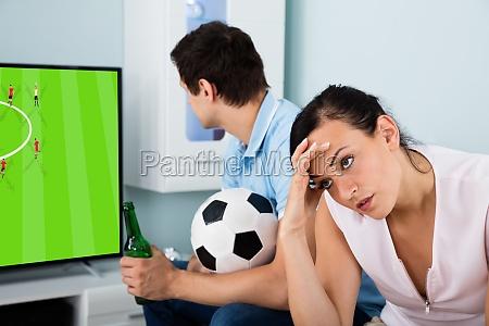 sad woman sitting beside a man