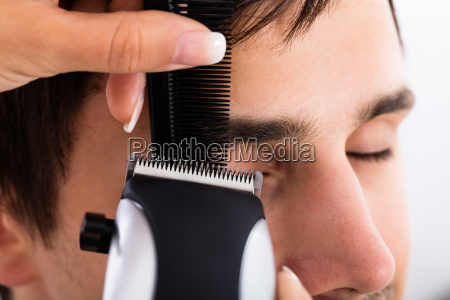 close up of a hairdresser cutting