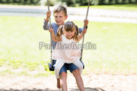 brother, and, sister, enjoying, on, swing - 19412676