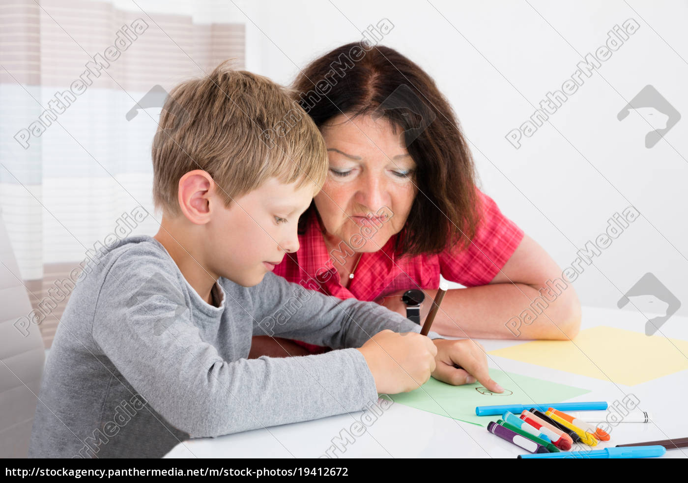 grandson, drawing, on, colorful, paper, at - 19412672