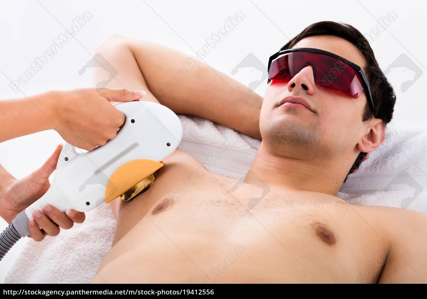 man, receiving, laser, epilation, treatment, on - 19412556