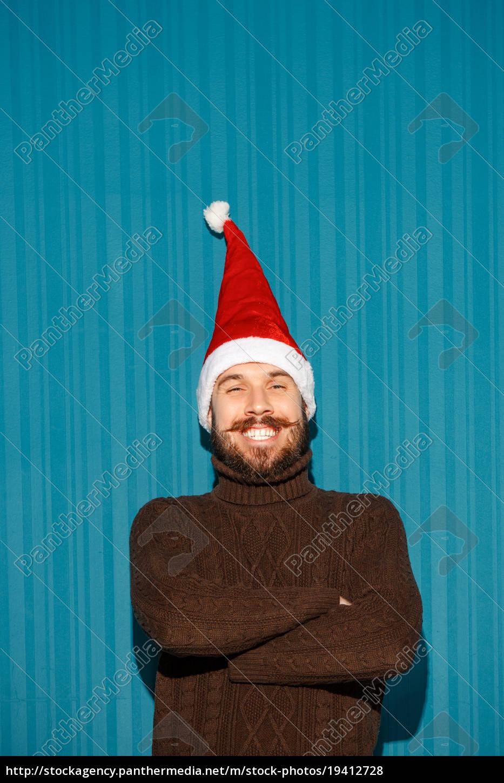 smiling, christmas, man, wearing, a, santa - 19412728
