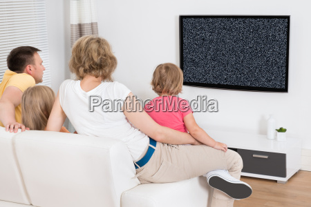 young, family, watching, tv, together - 19412436