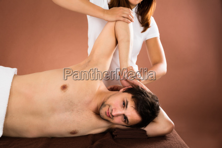 young, man, getting, massage - 19412460