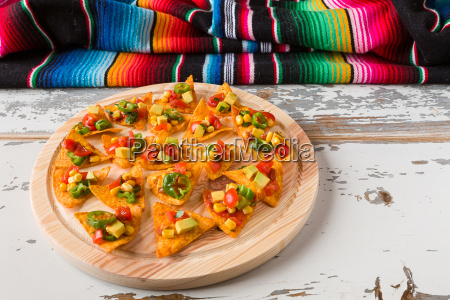 nachos, chips, with, vegetables, on, a - 19419358