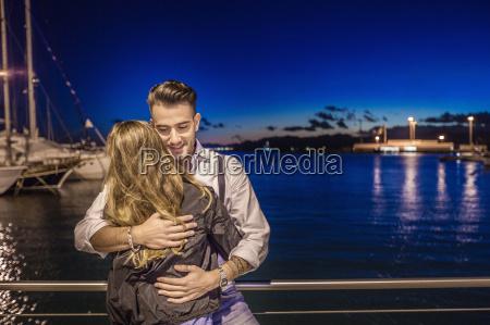 couple hugging by port cagliari sardinia