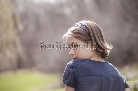 rear view of girl looking over