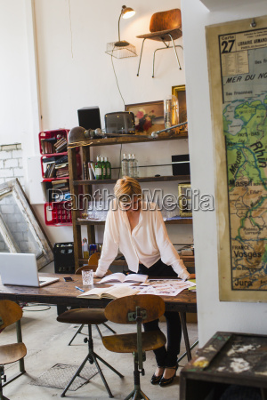 mid adult woman working in creative