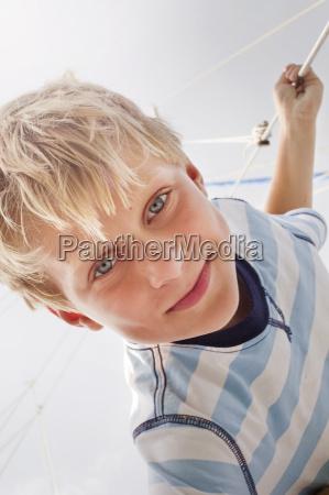 portrait of boy on sailboat