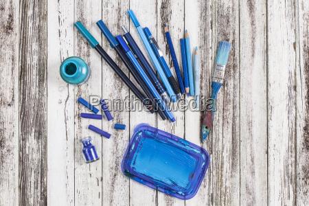 still life of blue paint brush