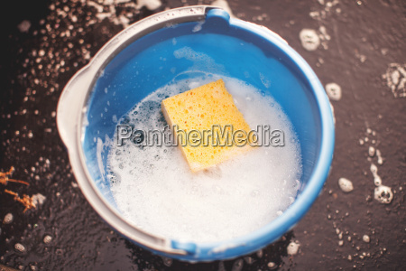 bucket of water with sponge