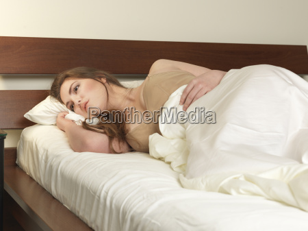 sultry young woman lying on hotel