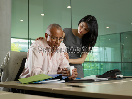 a woman comforts a man
