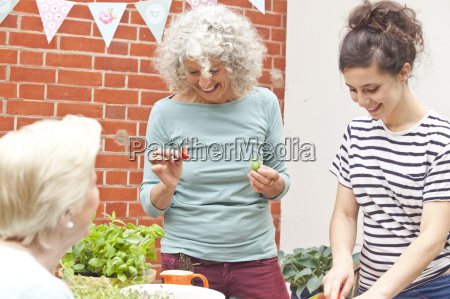 three women preparing fresh food at