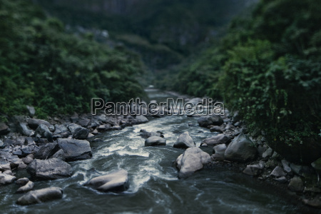 view of flowing stream with rocks