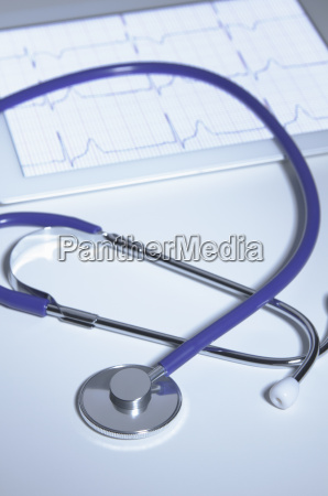 acoustic stethoscope over digital tablet displaying