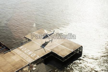 helicopter hovering over riverside helicopter landing