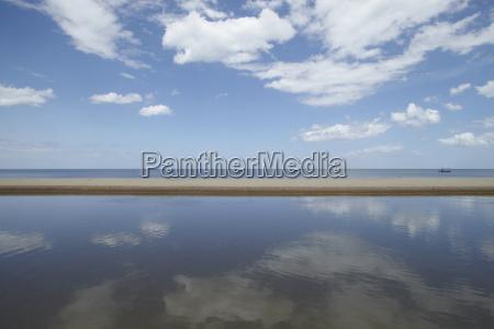 cloudy blue skies and ocean hua
