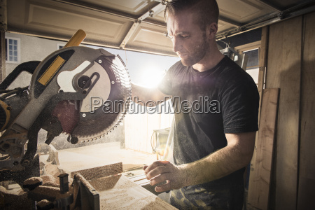 male carpenter working with a rotary