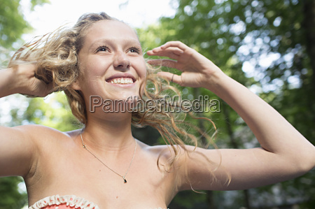 teenage girl expressing happiness and freedom