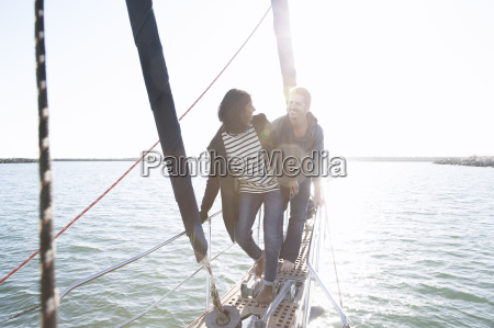 heterosexual couple on sailboat