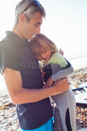 father and daughter on beach encinitas