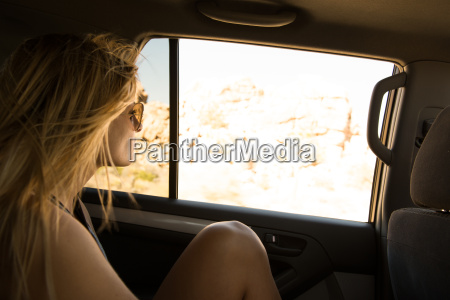 young woman looking out of back