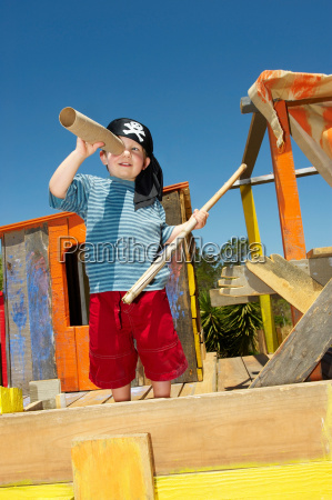 young boy playing pirates