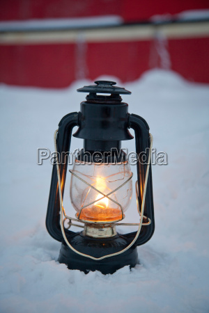 an oil lantern lit near the