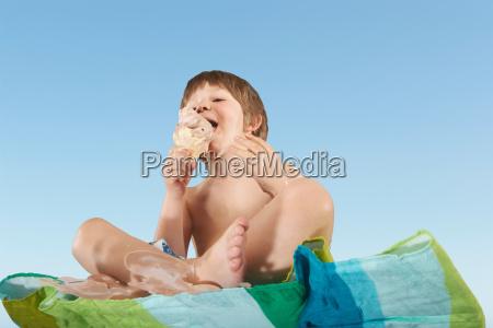 boy eating dripping ice cream cone