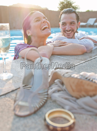 couple in swimming pool dressed