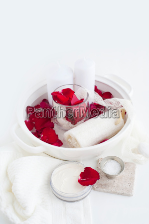 candles and rose petals in dish