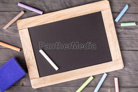 blackboard purple sponge and white chalk