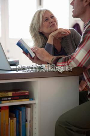 older couple reading phrase book