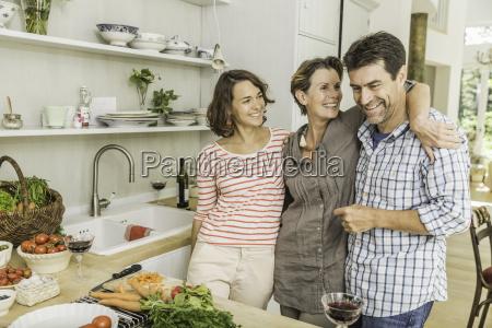 portrait of three adults preparing fresh