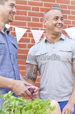 two male friends laughing and preparing