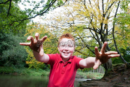 boy pretending to be a monster