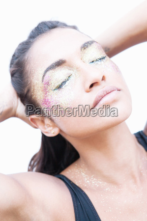 model wearing glitter over eyes and