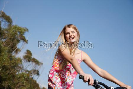 woman smiling riding mountain bike