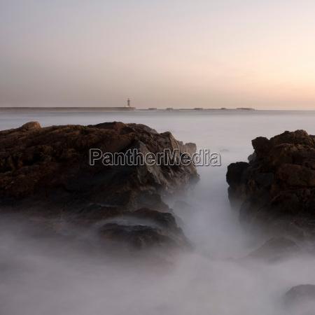 sunset at coast porto portugal